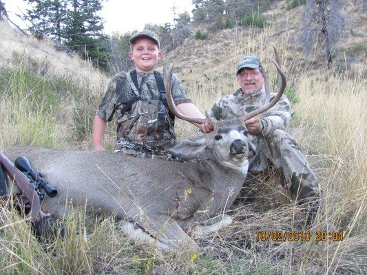 Tanner and his proud father Steve with Tanner's first buck. Great Kid!!!