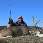 Ben Logan of Sarvis Prairie Outfitters wacks another great Hawk buck