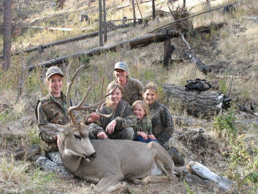 Jessica L & the Logan Family with Jessica's first buck taken in 2006.  All girls hunt!!!