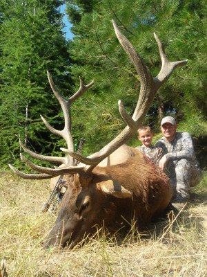 Hunter W. and his dad guide Mark W. with Hunter's first archery elk.  6x6 taken at age 10.  WOW!!!